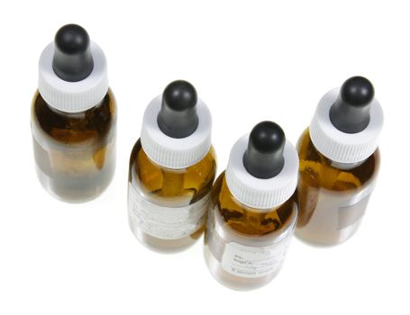Four dropper bottles with naturopathic medicine in them.