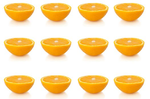 twelve small orange halves arranged in horizontal lines along the bottom, middle and top of the image and over white.