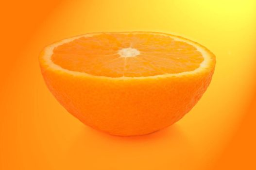 Close and low level capturing half an orange with yellow and orange light filter effect.