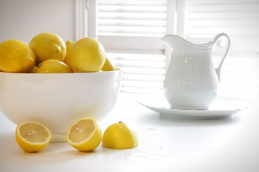 Lemons in large bowl on table