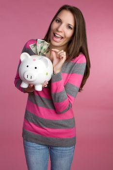 Woman holding piggy bank money
