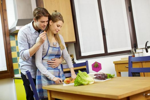 couple cooking vegetables in domestic kitchen