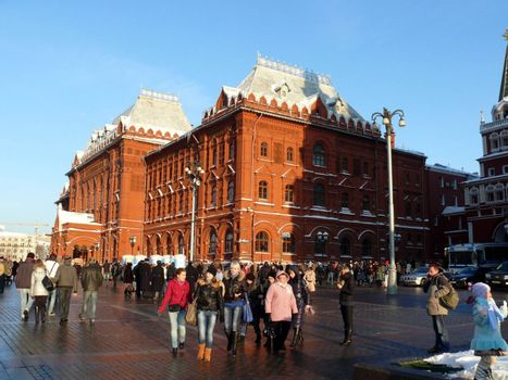 Moscow, Russia - February 23, 2010: Winter day. Peoples walks near national historic musium in Moscow, Russia