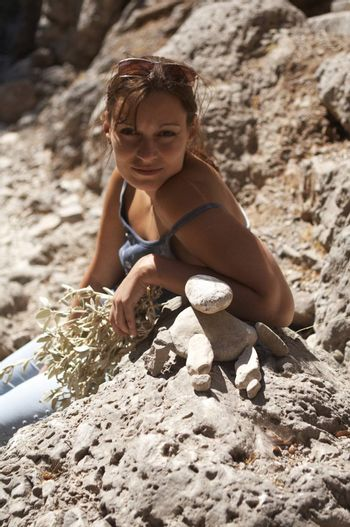 Young Woman Built Stone Stacks