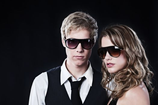 Young handsome man and young pretty woman in sunglasses