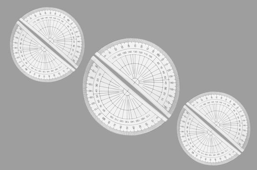 Several plastic protractors arranged in formation over light grey.