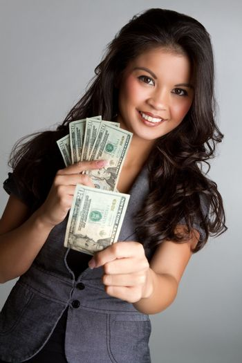 Smiling asian woman holding money