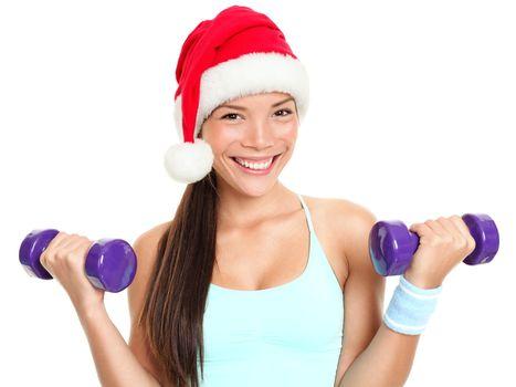 Christmas fitness woman wearing santa hat