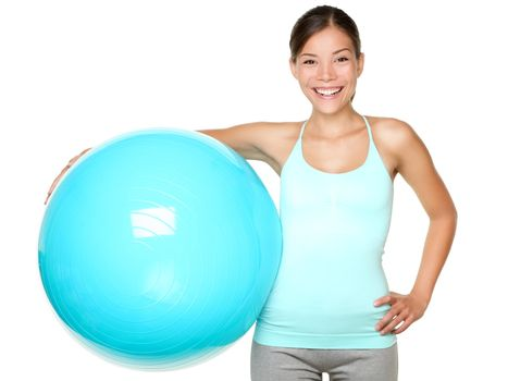 Fitness woman holding pilates ball