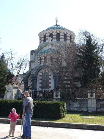 Pleven, Bulgaria - March 03, 2010: Spring day. Peoples walks near St George the Conqueror Chapel Mausoleum. Pleven, Bulgaria