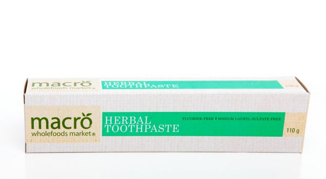 Macro Herbal Toothpaste which contains no fluoride and is free of sodium lauryl sulphates.  White background.  Editorial Use Only.