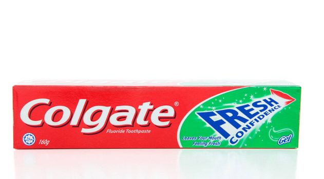 Colgate brand Fresh Confidence mint gel toothpaste.  Containing fluoride, halal certified.  Colgate toothpaste does not contain animal ingredients or alcohol.  The calcium in Colgate toothpaste is sourced from minerals.  The glycerin in Colgate toothpaste is sourced from plants.  White background.  Editorial Use Only.