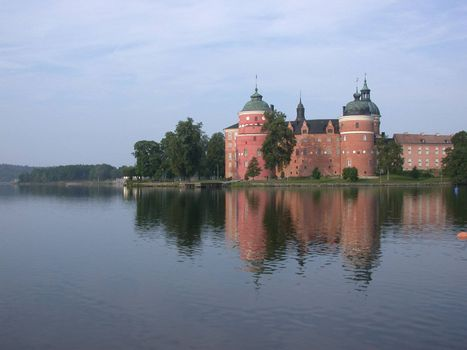 Gripsholm castle, Mariefred in Sweden. This place was first fortified in late 14 century, by a man who the castle is named after (Grip). The fort was confiscated by the Swedish king Gustav Vasa in the middle of 16th century. The oldest remanings on the castle you see here, are from around 1520s. The castle is located in the municpally of Strangnas about 60 km west of Stockholm and is still today one of the castles in Sweden that the Swedish Royal family takes care of. The castle is also holding the states National Collection of Portraits