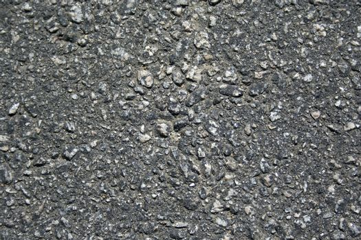 A straight on view of street pavement for use as a background or texture.