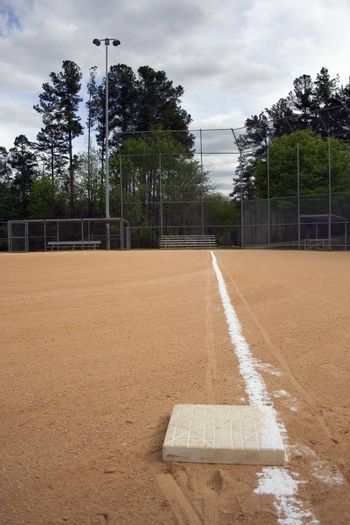 Looking down the third base line on a baseball field, the home stretch.