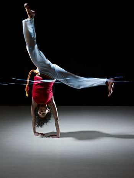 hispanic woman doing capoeira martial art