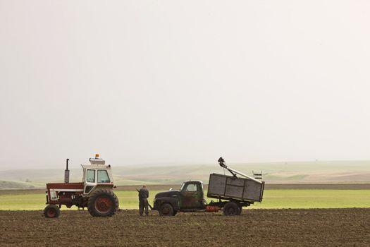 Old Farmer working on Farm Vehicles