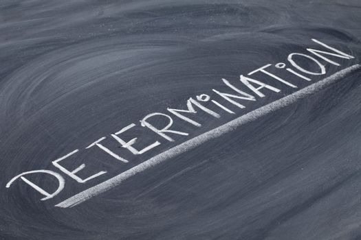 determination word on blackboard