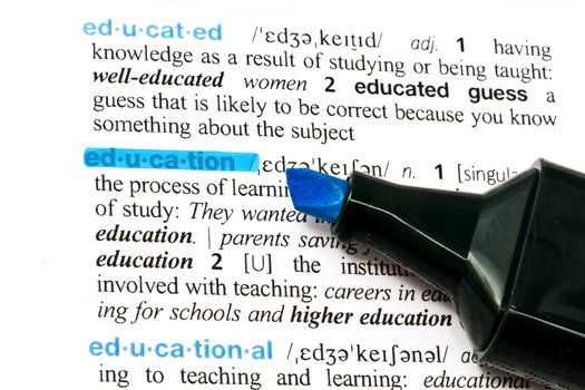 The word EDUCATION highlighted in a dictionary