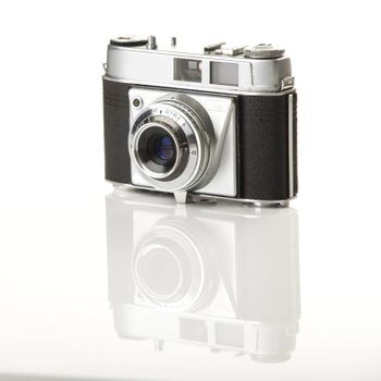 Old fashioned photography camera isolated over a white background