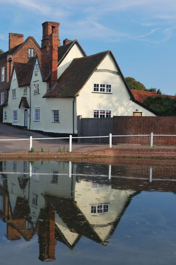 Cottages reflected on village pond