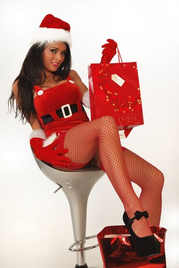 sexy santa sitting on stool