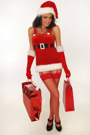 Sexy female santa with gifts