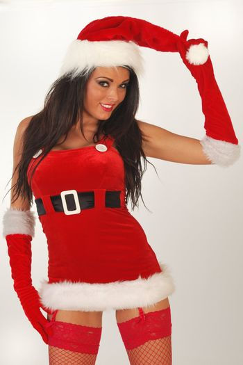 Sexy female santa in mini skirt outfit