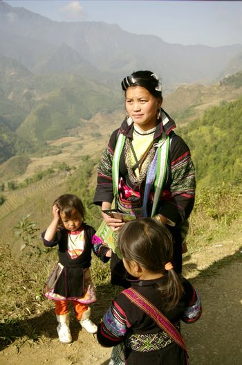 Woman of the ethnic (minority) Hmong black region of SAPA. She carries a baby in the back. She is 27 and already has two other children