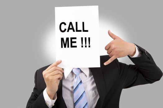 Businessman holding call me billboard