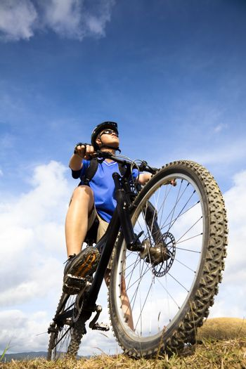 Mountain Biker and blue sky background
