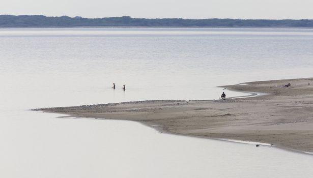 People at lake shore