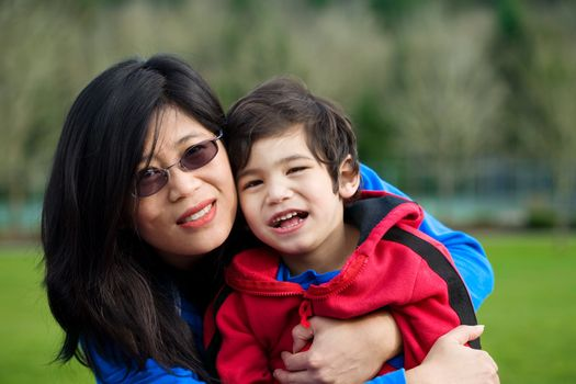 Asian mother and son together at park