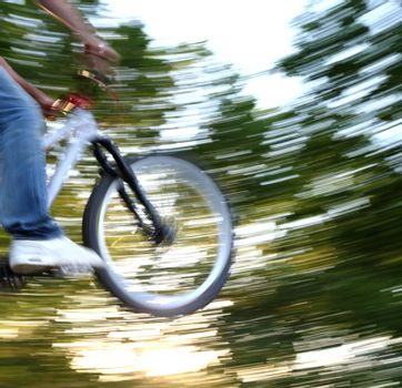 young airborne bmx biker (motion blur is used to convey movement