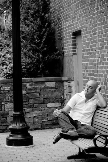 Casual Guy Sitting on a City Bench