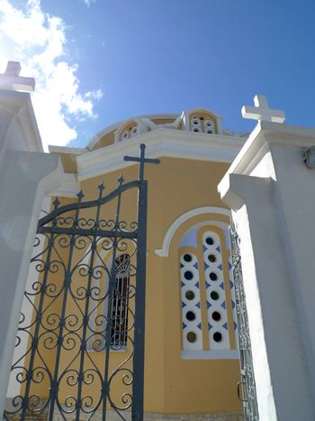 colorful Greek cathedral with an open gate
