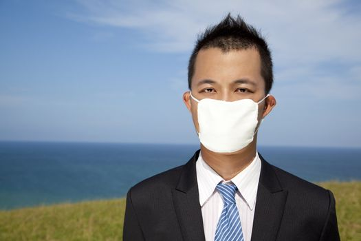 Businessman in depression with mask