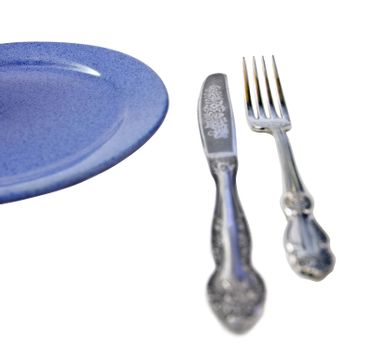 knife fork and blue plate