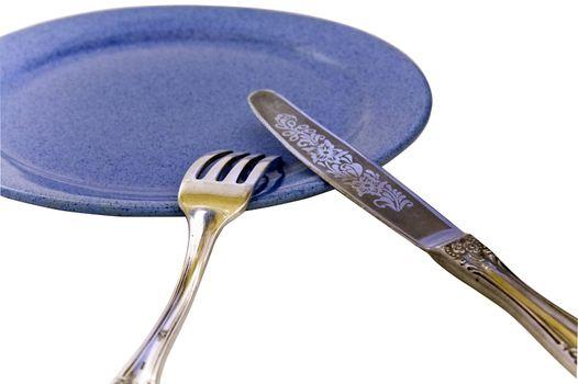profile fork knife on blue plate