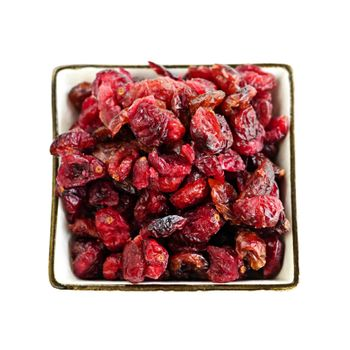 Bowl of dried cranberries isolated on white background