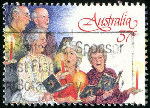 AUSTRALIA - CIRCA 1987: stamp printed by Australia, shows Christmas, three women, two men, circa 1987