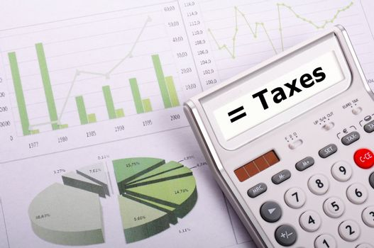 tax or taxes concept with business calculator and word