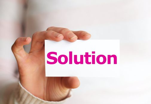 problem and solution concept with hand word and paper