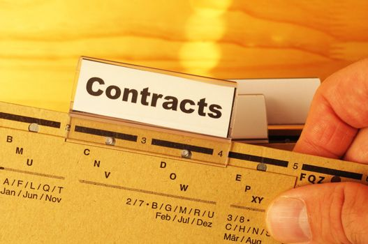 contract word on business folder showing trade or financial concept