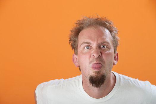 Man Sticks Out His Tongue