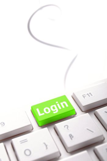 sign in or login concept with key on computer keyboard