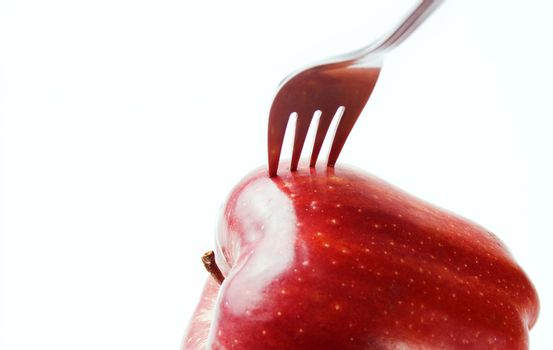 Apple with a fork stuck