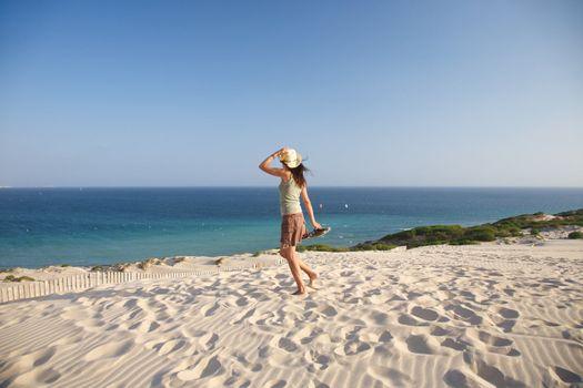 woman walking over Atlantic ocean