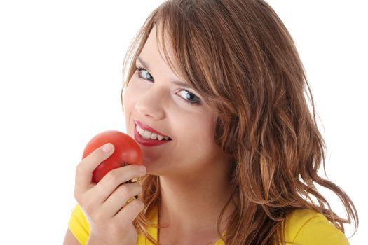 Woman eating tomato