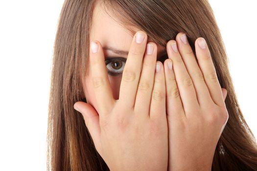 Frightened girl hiding her face